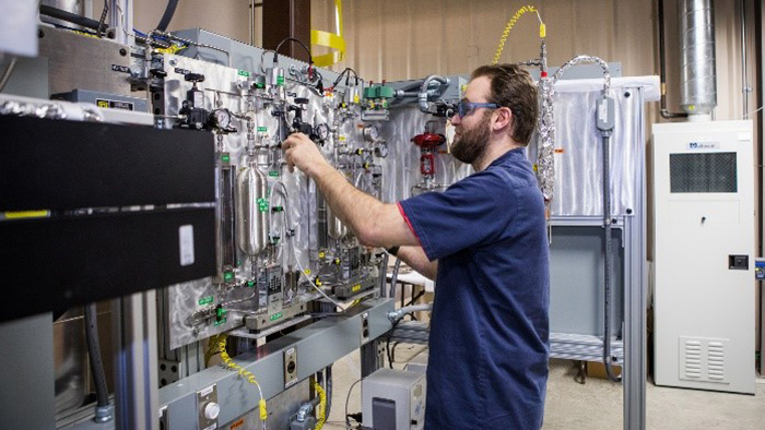 John Johnson operates a state-of-the-art variable frequency microwave reactor in the newly commissioned Reaction Analysis and Chemical Transformation (ReACT) facility in Morgantown.