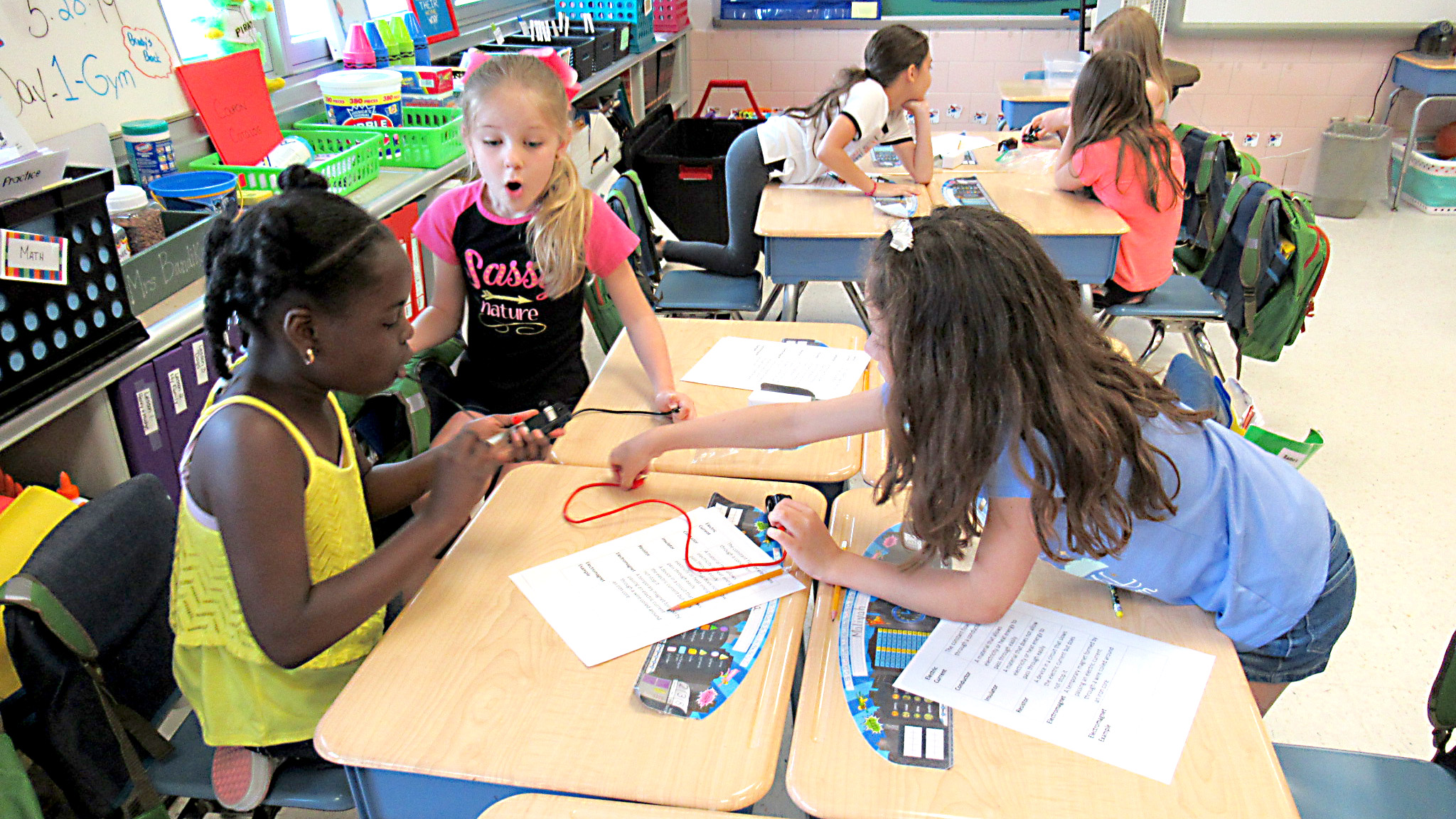 "Students at Clara Barton Elementary School participate in the ""Simple Circuits"" activity to learn about the concept of electricity."
