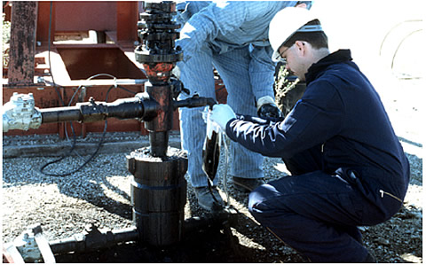 INL researchers sample a wellhead to conduct fluid analysis and microbial ecology and physiological characterization tests.