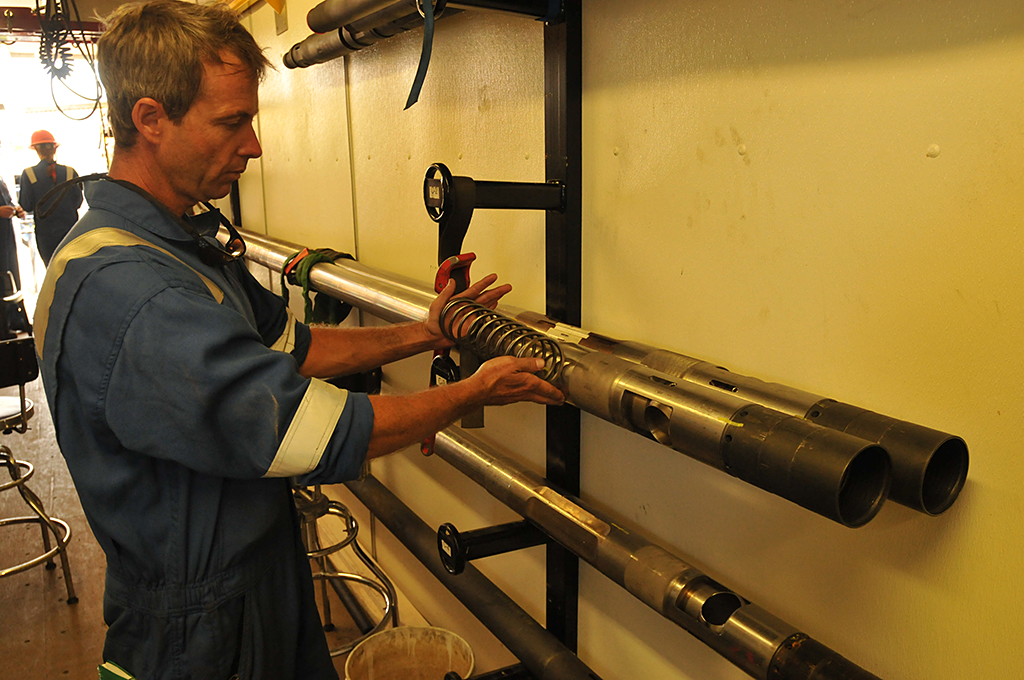 The science team prepares the PCTB pressure coring tool for deployment at GC955.