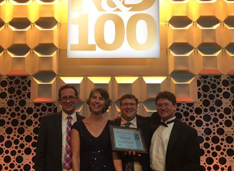 Accepting a 2017 R&D 100 Award at festivities in Orlando, FL are team members, left to right, Bob Dilmore of NETL, Elizabeth Keating of Los Alamos National Laboratory (LANL), Grant Bromhal of NETL, and Phil Stauffer of LANL. The team's product, the National Risk Assessment Partnership Toolset, was designated as one of the top 100 technologies of the year.
